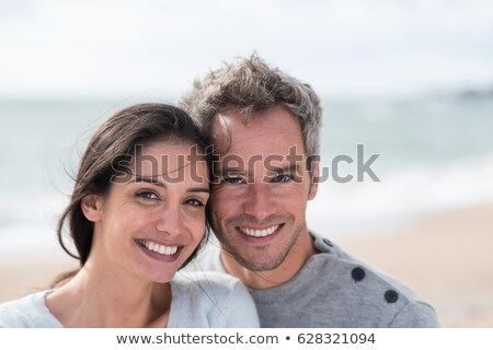 Happy middle aged couple outdoors on beautiful autumn day Stock photo © Lopolo