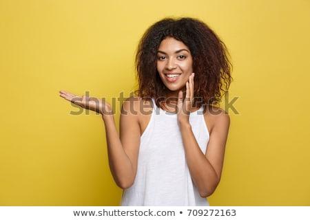 Gülen genç kadın bir şey hayali güzellik Stok fotoğraf © dolgachov