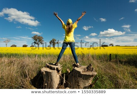 woman enjoys the countryside views fields of golden canola stock photo © lovleah