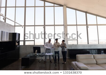 front view of mixed race business people discussing over house model in modern office stock photo © wavebreak_media