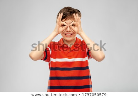 boy in pullover looking through finger glasses Stock photo © dolgachov