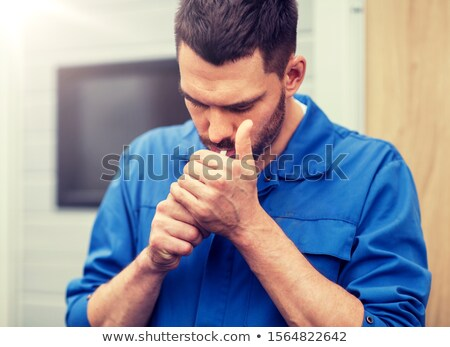 auto mechanic smoking cigarette at car workshop Stock photo © dolgachov