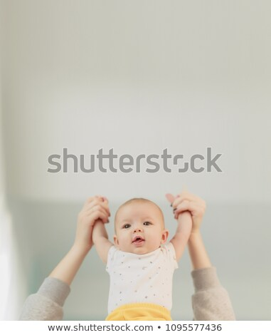 Mother breastfeeding her little baby boy in arms. Stock photo © Lopolo