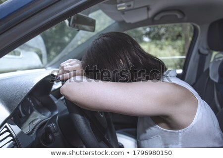 Young female driver at the wheel of her car, super tired Stock photo © lightpoet