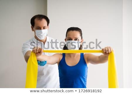 Terapeuta banda resistência ombro cara máscara Foto stock © AndreyPopov