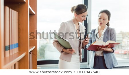 Asian and European lawyer in their law firm working Stock photo © Kzenon