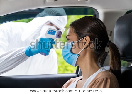 Medical staff take temperature drive thru service Stock photo © vichie81