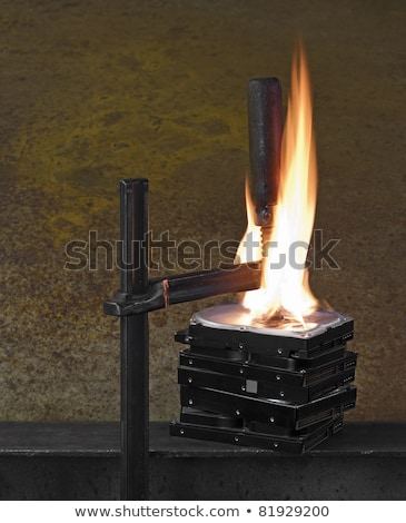 flames on stack of pressed hard drives Stock photo © gewoldi