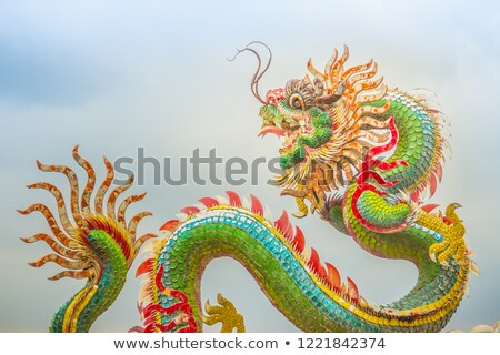 blue chinese dragon wrapped around red pole stock photo © nuttakit