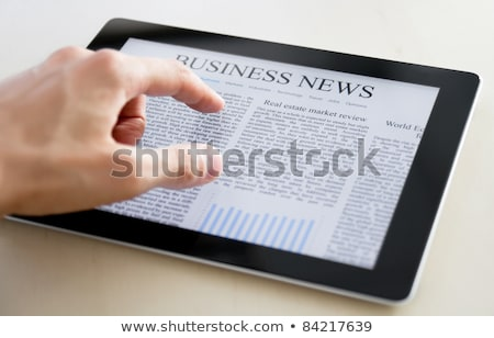 Stock fotó: Business News On Tablet Pc