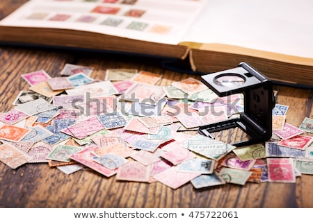 magnifier and collection stamps stock photo © andriy-solovyov