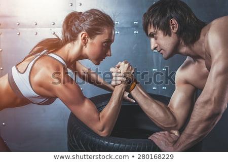 Sportok nő kéz markolás képzés mosoly Stock fotó © pedromonteiro