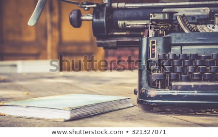 antique typewriter a white backdrop stock photo © ozaiachin