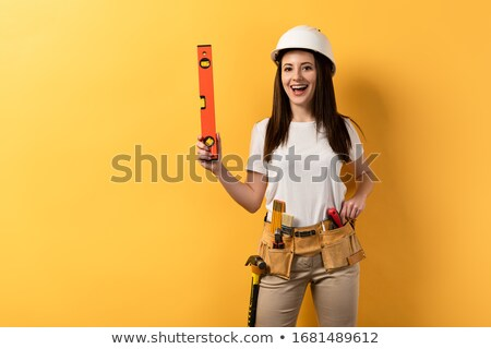 Handywoman holding spirit level Stock photo © photography33