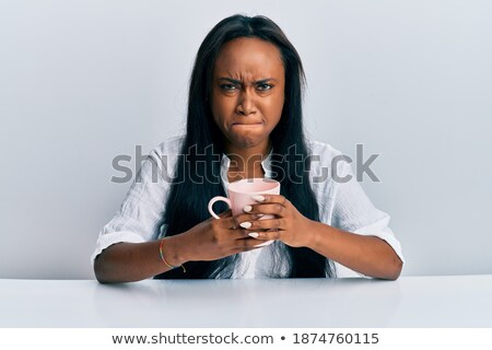 upset young woman with cup of espresso coffee Stock photo © Rob_Stark