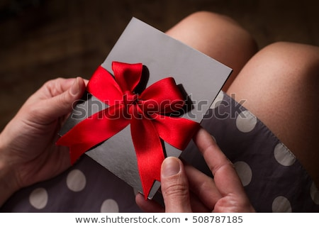 gift card woman in red dress stock photo © ariwasabi