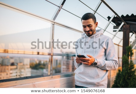 Foto stock: Man Checking E Mail On Smartphone