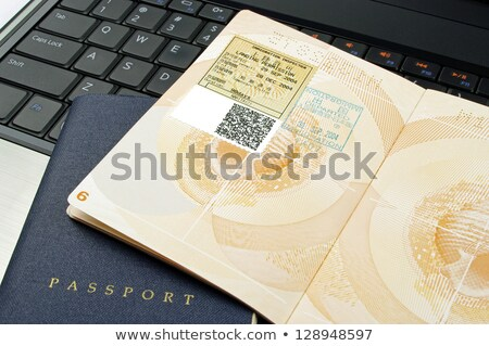 Açmak pasaport bilgisayar göç damga dizüstü bilgisayar Stok fotoğraf © luapvision