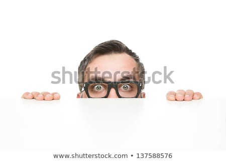 businessman peeping from behind the blank board stock photo © stockyimages