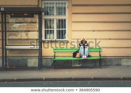 woman sitting on bench in station stock photo © photography33
