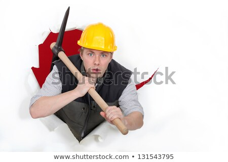 Worker bursting through with a pickaxe Stock photo © photography33