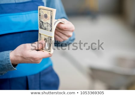construction worker holding up money stock photo © photography33