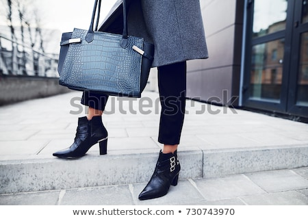 Woman holding blue shoes stock photo © grafvision