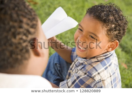 Mixed Race Father and Son Playing with Paper Airplanes stock photo © feverpitch