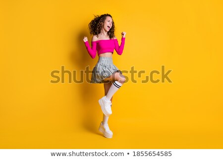 long legs and checkered skirt Stock photo © dolgachov