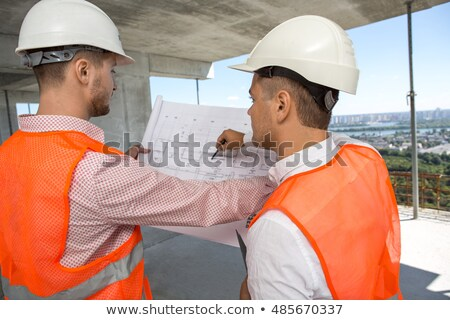 two construction workers exchanging ideas stock photo © photography33