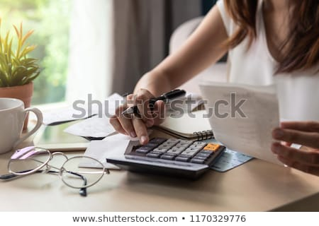 Calculating expenses Stock photo © Melpomene