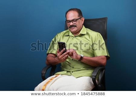 mosolyog · üzletember · küldés · szöveges · üzenet · kávézó · profi - stock fotó © photography33