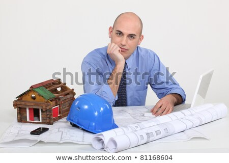 Architect with plans and model of a log cabin Stock photo © photography33
