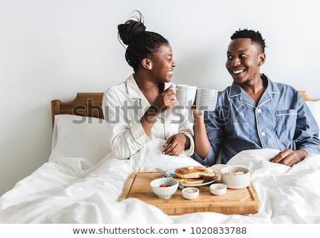 cute · paar · ontbijt · bed · home · slaapkamer - stockfoto © photography33