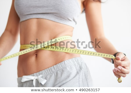 Foto d'archivio: Young Beautiful Woman Measuring Her Waistline Perfect Slim Body
