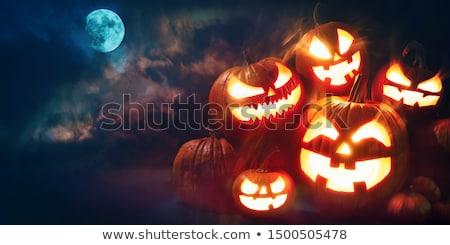creepy pumpkin for halloween stock photo © sumners