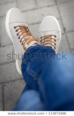 Stockfoto: Half Body Of A Male Teenager Sitting Cross Foot
