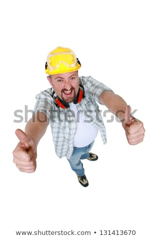 Quirky handyman giving two thumbs-up Stock photo © photography33