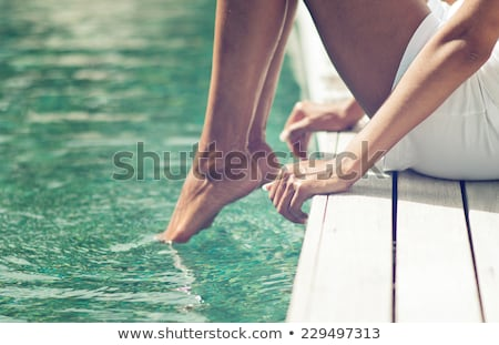 Woman dipping her feet in the water Stock photo © photography33