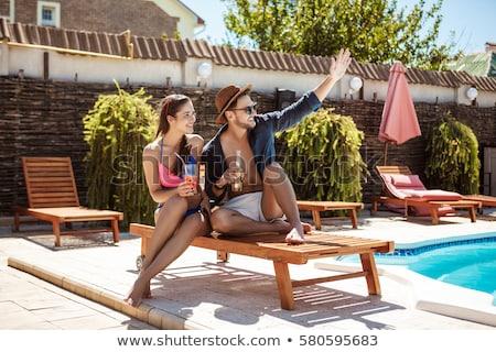 Girl near pool stock photo © Aikon