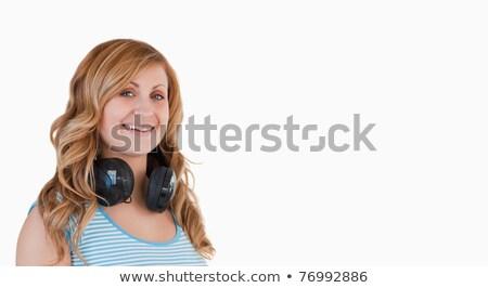 geïsoleerd · vrouw · poseren · hoofdtelefoon · rond · nek - stockfoto © wavebreak_media