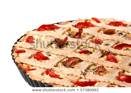 A slice of vegetable tart with tomatoes and prosciutto stock photo © deymos
