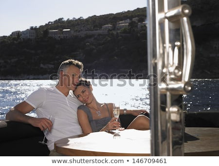 A nice couple having a flute of champagne. Stock photo © photography33