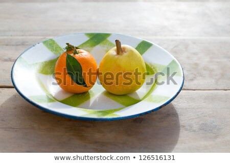 fruits tangerine and pear in vintage porcelain dish plate retro stock photo © lunamarina