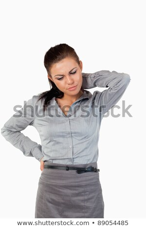 Portrait of a depressed businesswoman having back pain against a white background Stock photo © wavebreak_media