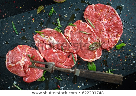 Raw beef steaks and lamb chops on wooden table  Stock photo © Kesu