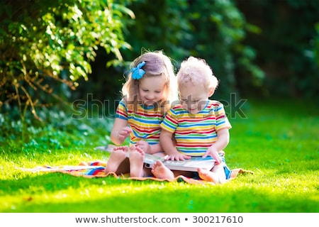 Beautiful twin little girls doing homework stock photo © lunamarina