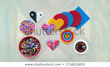 colorful beads heart shape stock photo © discovod