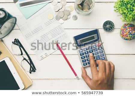 Balancing the Accounts. Calculator, pen Stock photo © REDPIXEL