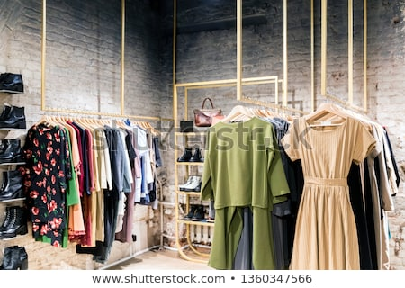A female consumer shopping in an clothes store Stock photo © HASLOO
